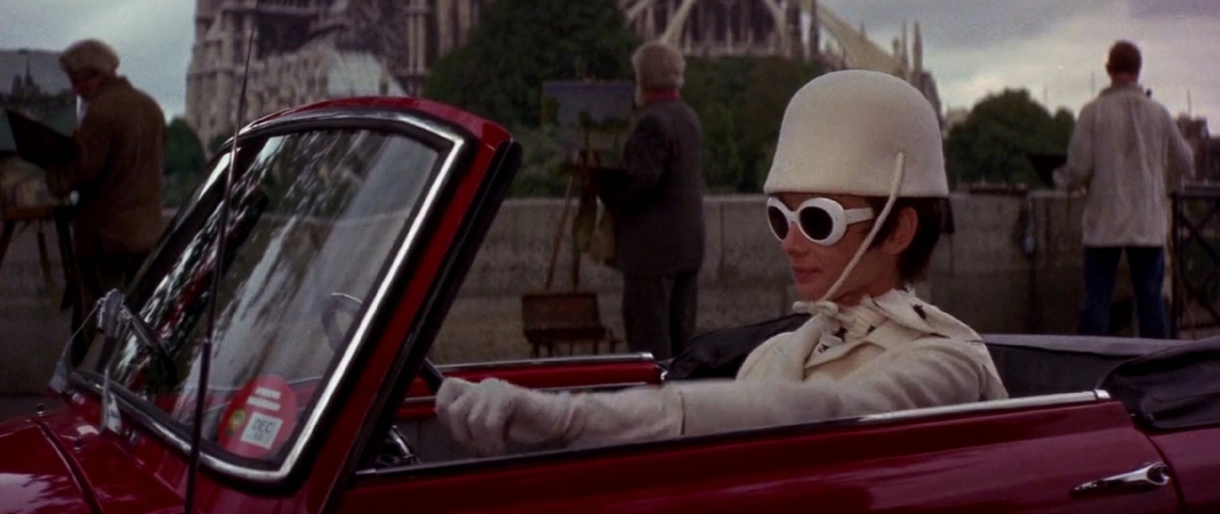 Audrey Hepburn driving through Paris wearing Givenchy in 'How to Steal a Million.' Photo