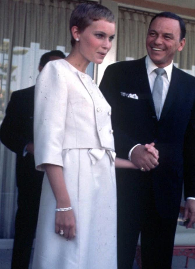 Frank Sinatra with Mia Farrow on their wedding day July 20, 1966. She is wearing her 9-carat pear shape diamond engagement ring and bracelet from Ruser. Photo AP
