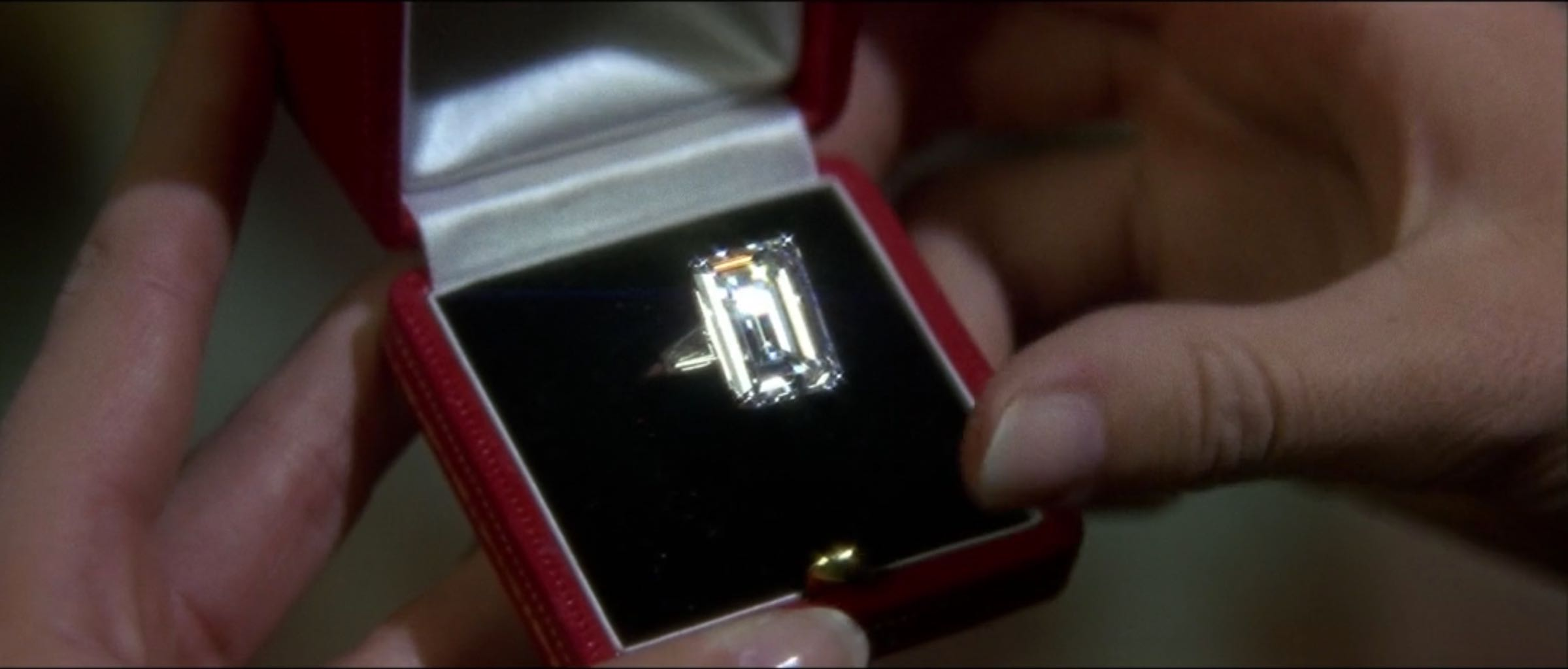 Close up of Audrey Hepburn's Cartier engagement ring in 'How to Steal a Million.' Photo via