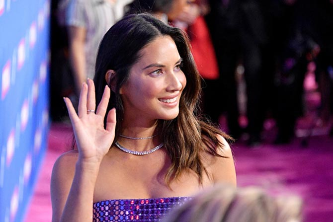 Olivia Munn sparkled in a David Koma strapless dress and Kismet by Milka diamond choker with rings not seen in photo—a Kavant&Sharart diamond ring and two diamond rings by Yeprem.