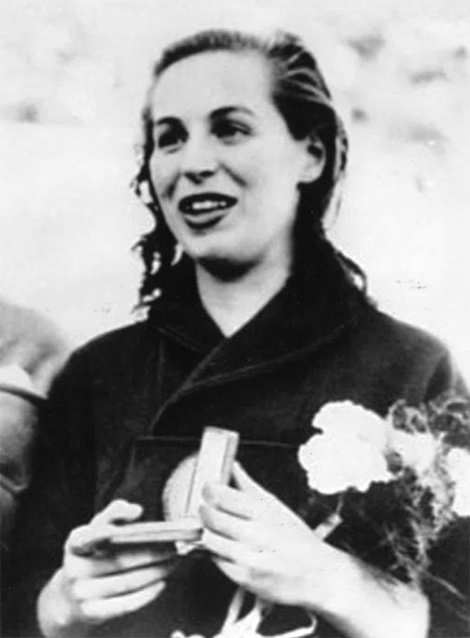 Katherine Arpad holding the gold medal she won with the Hungarian team during the 1952 Helsinki Olympics. Photo courtesy