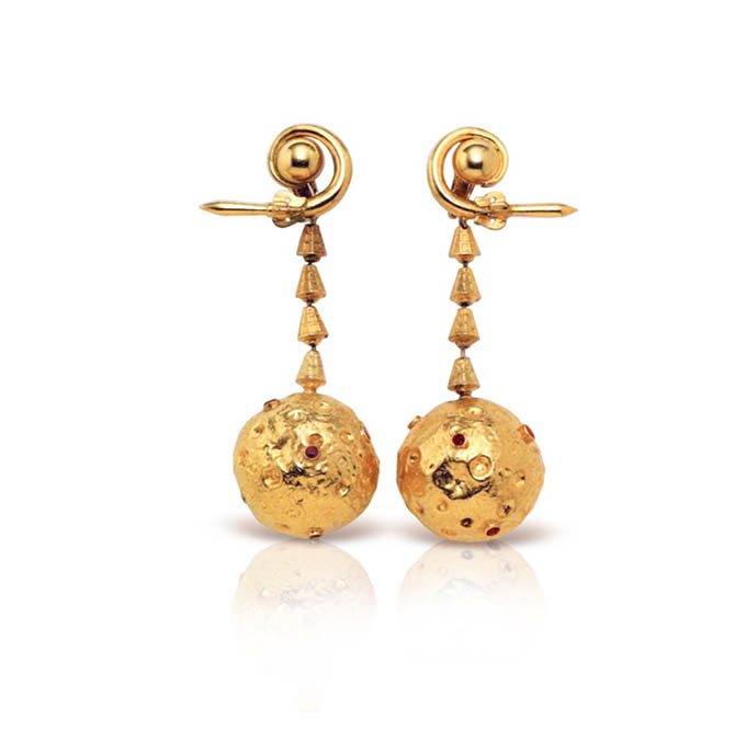 """The 18K gold and ruby """"Moon"""" Earclips made by LALAoUNIS in 1969 for Aristotle Onassis to give Jackie Kennedy Onassis. Photo courtesy"""