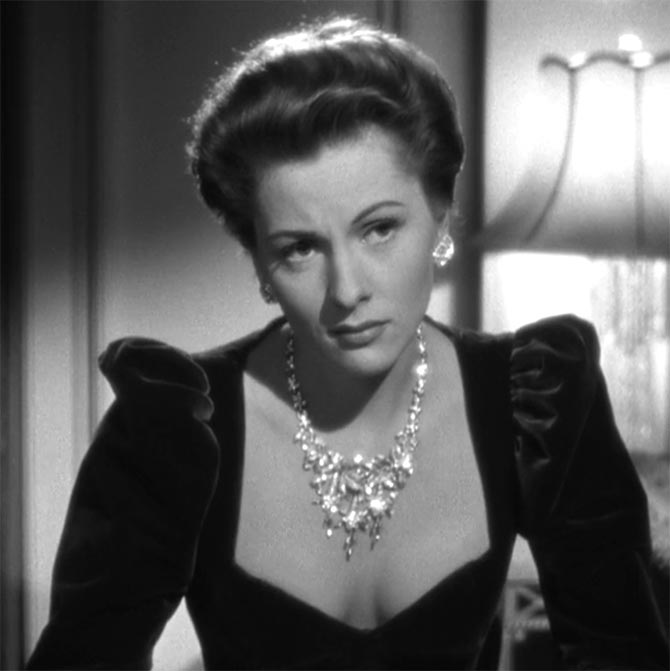 Joan Fontaine wearing her diamond floral necklace in a 'Suspicion.' Photo via