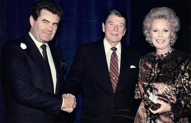 President Ronald Reagan with Arpad and Katherine Domyan who is wearing her enamel and diamond pendant necklace and bracelet by David Webb featured in the Bonhams auction. Photo courtesy