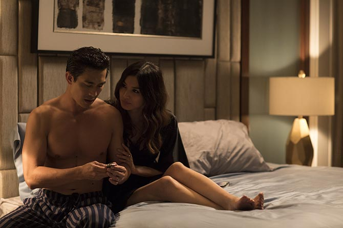 The moment in Crazy Rich Asians when Astrid (Gemma Chan) presents her husband Michael (Pierre Png) with the Rolex. Photo Warner Bros
