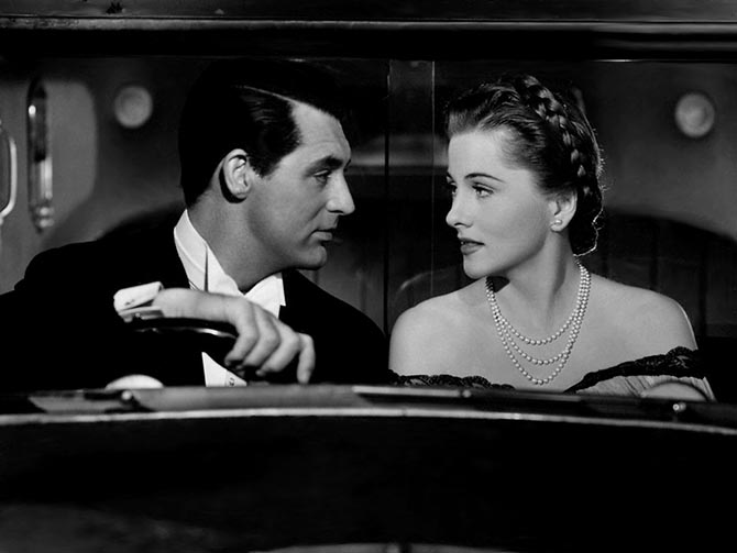 Cary Grant with Joan Fontaine wearing her triple strand of pearls in a scene in Suspicion. Photo Alamy