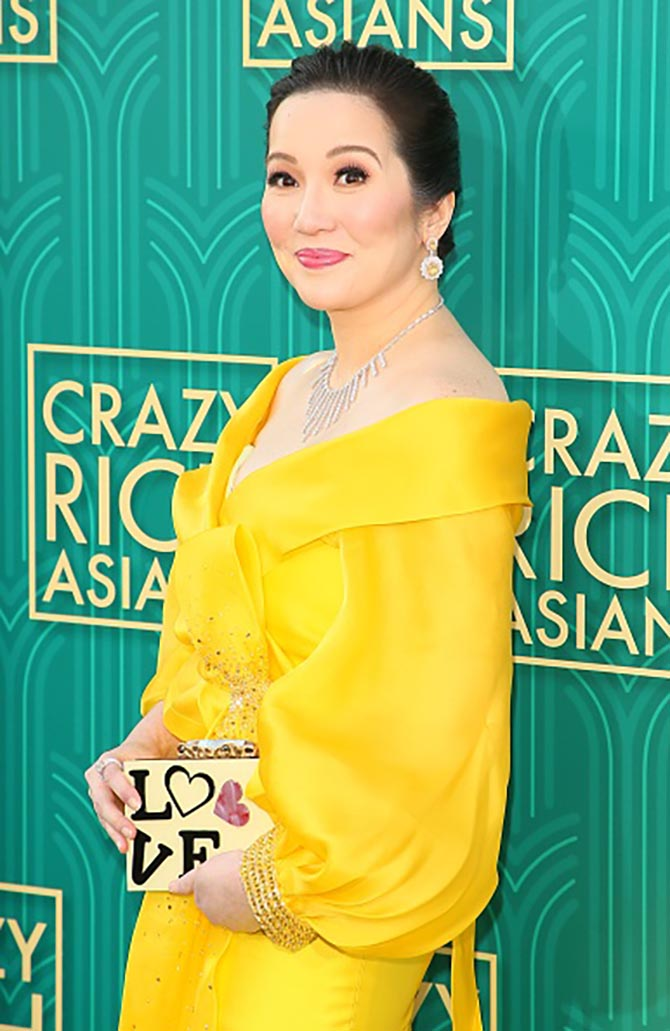 Kris Aquino-Yap wore a sunshine yellow gown with a white diamond bib and yellow and white diamond earrings.