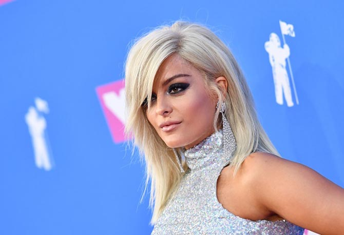 Bebe Rexha went matchy-matchy in her own way wearing a silver sequin outfit and 75-carats of Lorraine Schwartz white diamonds including her signature mesh diamond earring and mesh diamond rings.