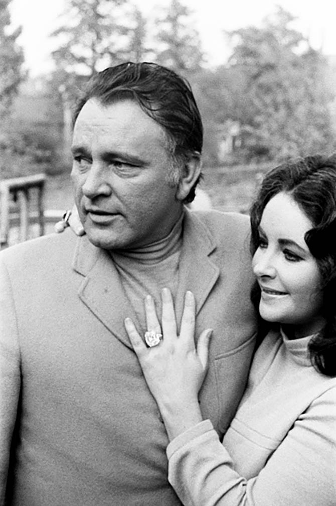 Richard Burton with Elizabeth Taylor who is showing the press her latest jewelry acquisition, the 33.19-carat Krupp diamond ring in 1968. Photo Getty