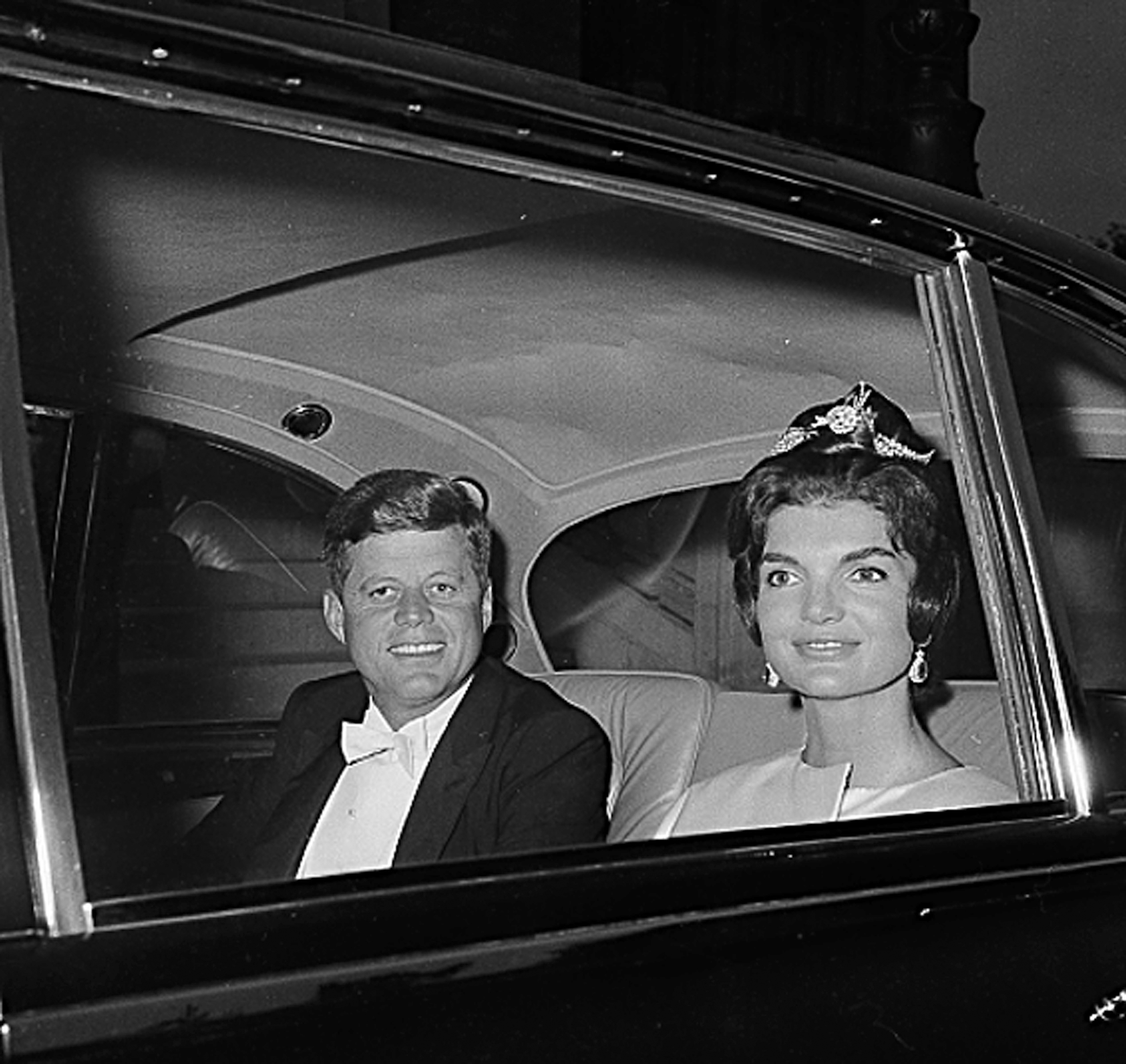 President John F. Kennedy with First Lady Jacqueline Kennedy as they leave their residence at Quai D'Orsay, Paris, for a state dinner in the Hall of Mirrors in Versailles on June 1, 1961. Jackie is wearing her Van Cleef & Arpels emerald and diamond earrings and clips in her hair. Photo AP Photo