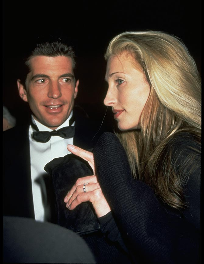John Kennedy with Carolyn Bessette-Kennedy who is wearing her sapphire and diamond eternity band engagement ring. Photo Getty