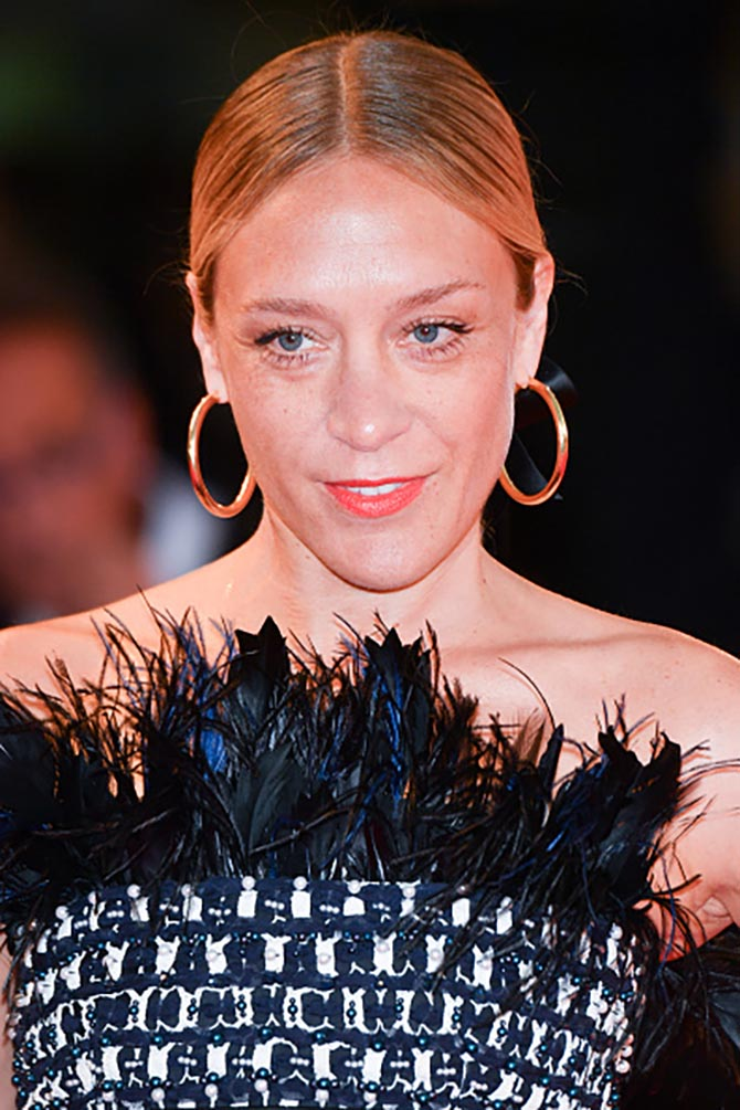 'At Eternity's Gate' screening Chloe Sevigny wore gold hoops with her Chanel mini dress.