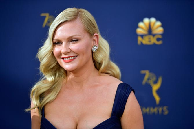 Kirsten Dunst in diamond double fan earrings by Suzanne Belperron from Fred Leighton.