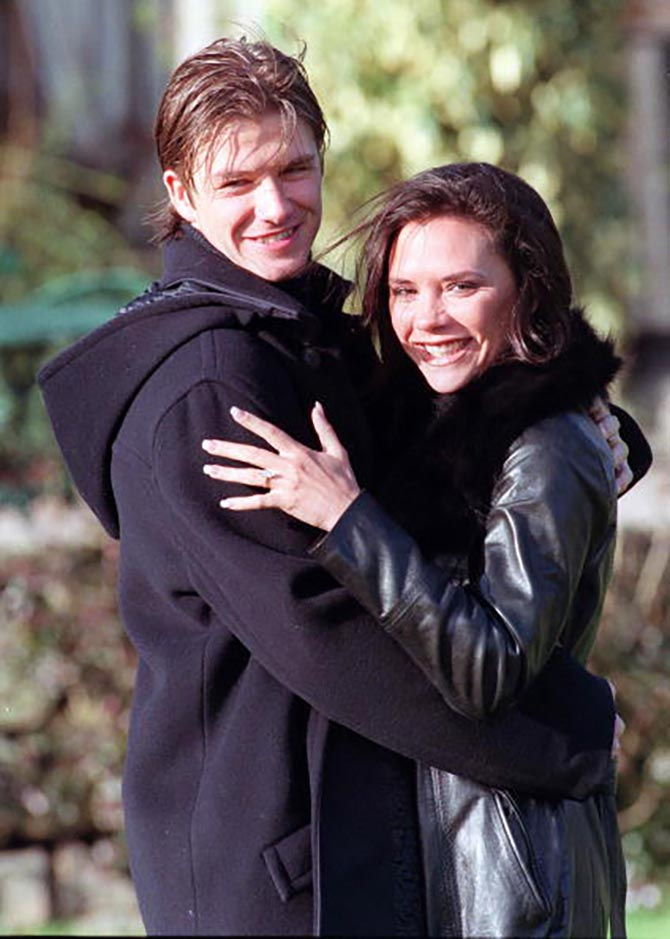 David Beckham and Victoria Adams wearing her engagement ring pose for photographers outside their hotel after the announcement of their engagement on January 25, 1998 in Chester, United Kingdom. Photo by Getty Images