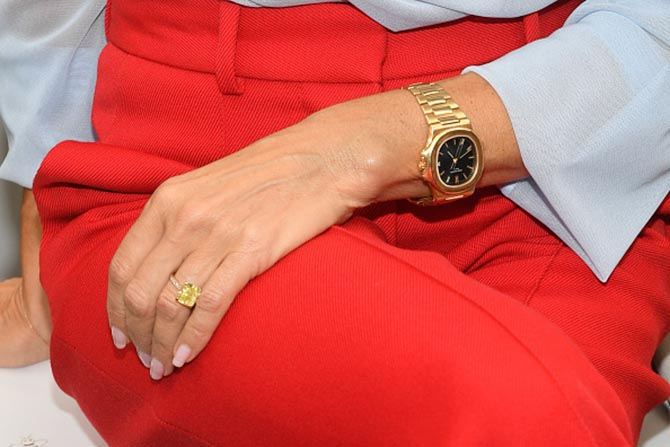 Detail of Victoria Beckham's square-cut yellow diamond engagement ring.