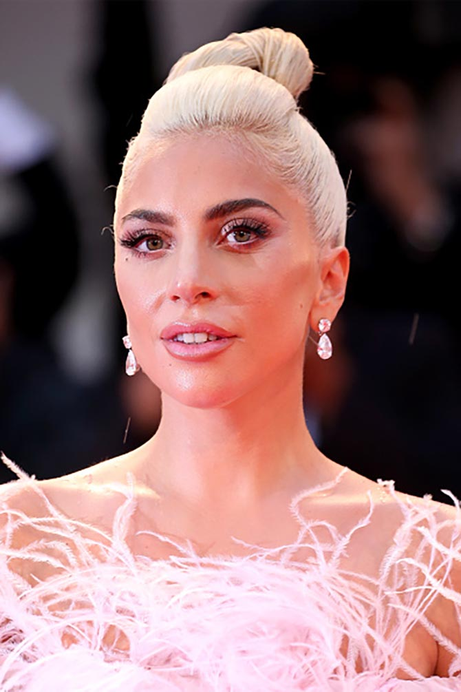Lady Gaga at the premiere of A Star is Born in pink couture Valentino gown and flawless diamond pendant earrings by Chopard. Photo Getty