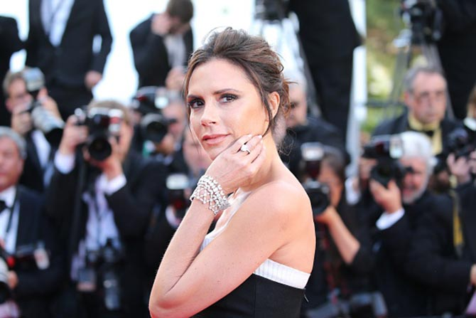 Victoria Beckham wearing her square cut diamond engagement ring with bracelets from Chopard in Cannes on May 11, 2016. Photo Getty