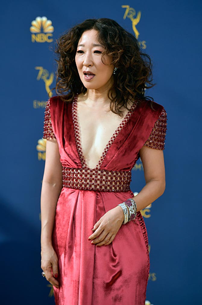 Sandra Oh in diamond, ruby and emerald bracelets.