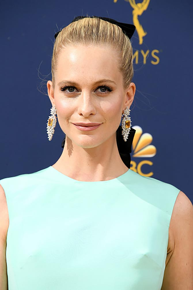 Poppy Delevingne wore Amwaj citrine and diamond earrings.