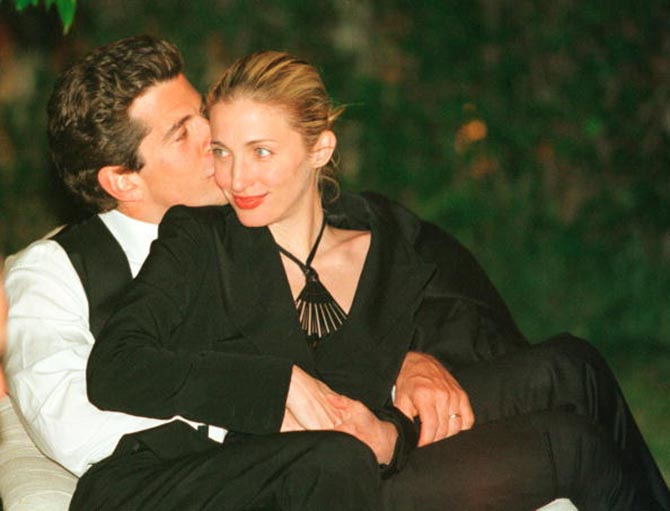 John F. Kennedy, Jr. gives his wife Carolyn Bessette-Kennedy a kiss on the cheek during the annual White House Correspondents dinner May 1, 1999 in Washington, D.C.