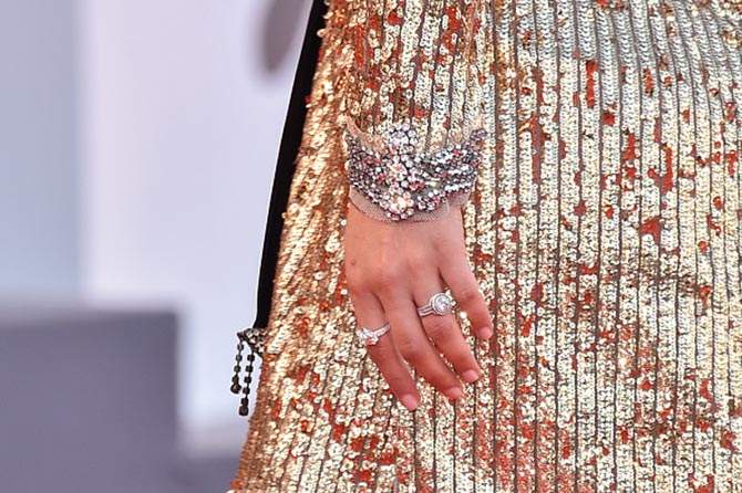 Detail of Natalie Portman's hand shows a Chopard diamond ring and her engagement ring designed by Jamie Wolf.