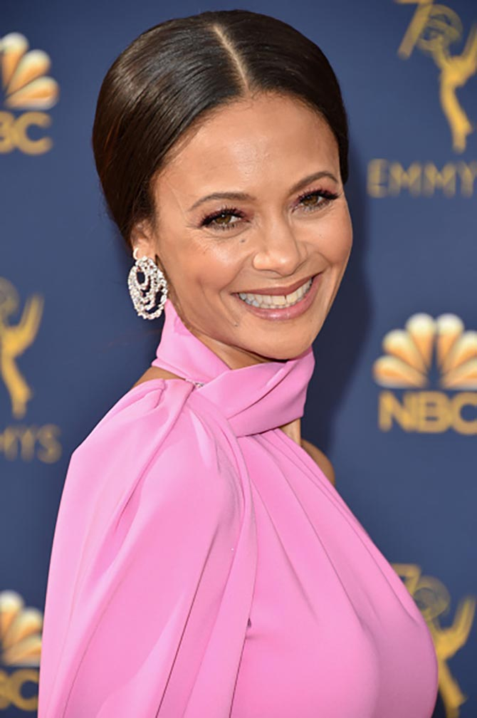 Thandie Newton wore Harry Winston Secret Combination 18.74-carat diamond and platinum hoop earrings.