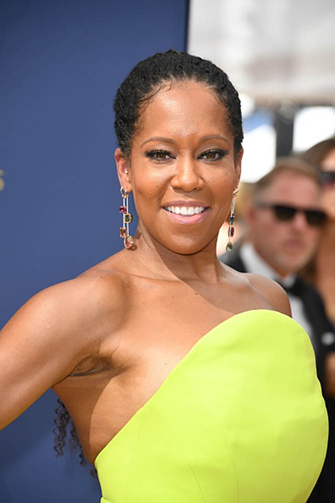 Regina King wore a selection of Irene Neuwirth One-of-a-Kind Single Earrings with Mixed Stones and Diamond Pave, paired with a One of a Kind Ring with Watermelon Tourmaline and Full Cut Diamonds.