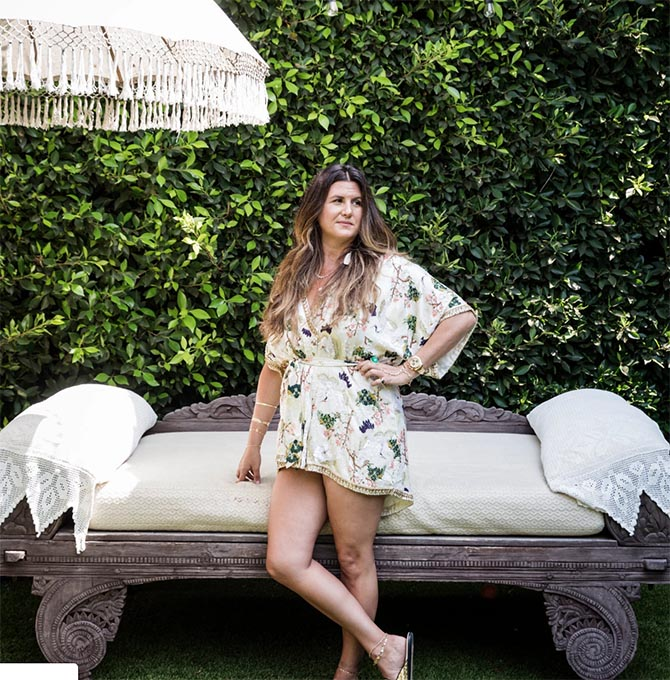 Jacquie Aiche in the garden of her Beverly Hills headquarters. PHoto Emily Berl for The New York Times