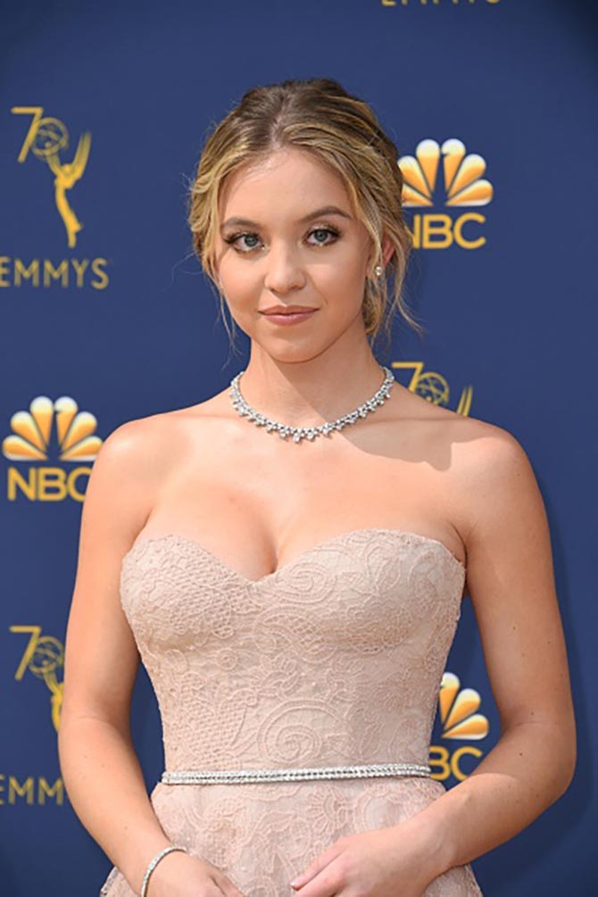 Sydney Sweeney wore in diamond studs, a diamond necklace in 18k White Gold, Art Deco diamond line bracelet in platinum from Beladora.