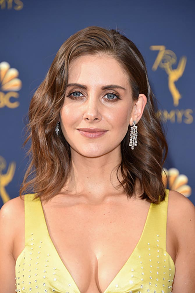 Alison Brie in Bvlgari diamond earrings.