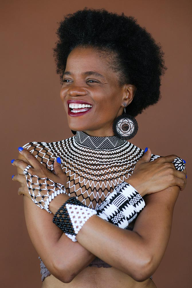 House of Yimama Founder Ntando Kunene wearing jewels from the collection. Photo Angela L Torress