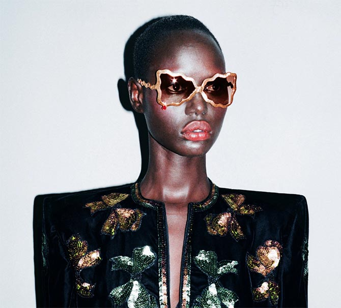 Ruby Teardrop sunglasses by Francis de Lara on a model Photo via The New York Times