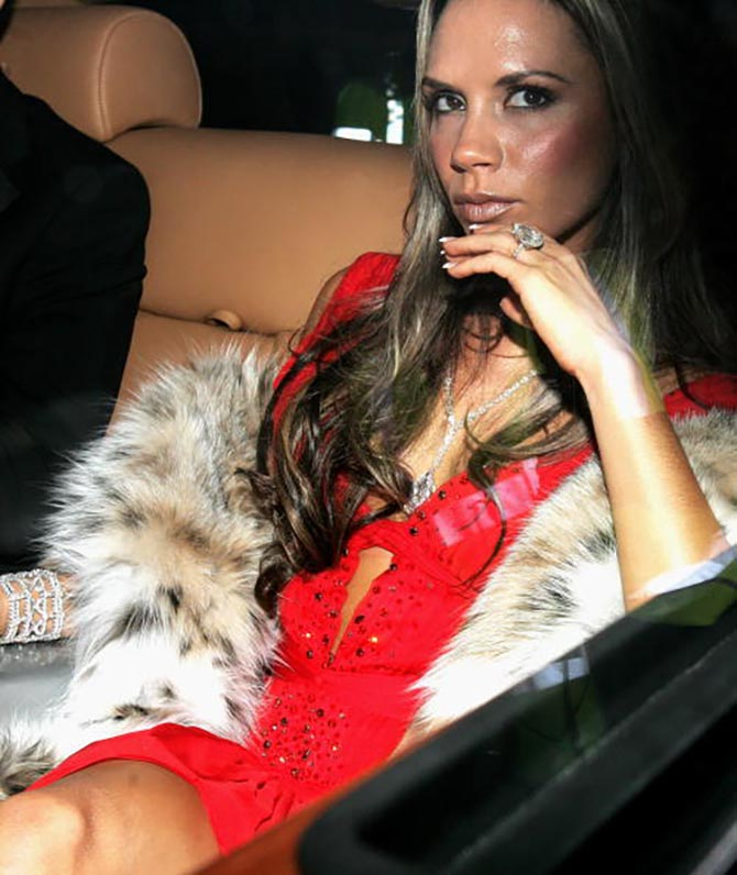 Victoria Beckham wearing her pear-shape diamond engagement ring with other diamond jewels to a party in 2005. Photo Getty