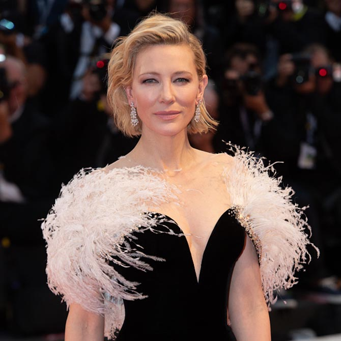 Cate Blanchett walk the red carpet ahead of the 'A Star Is Born' wearing Armani Prive and Chopard chandelier diamond earrings. Photo Getty