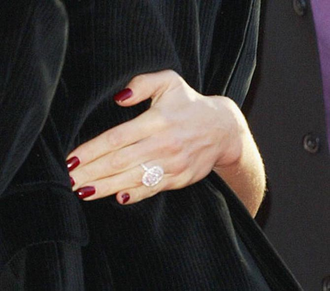 Detail shot of Victoria Beckham pink diamond engagement ring take at a party in 2004. Photo Getty