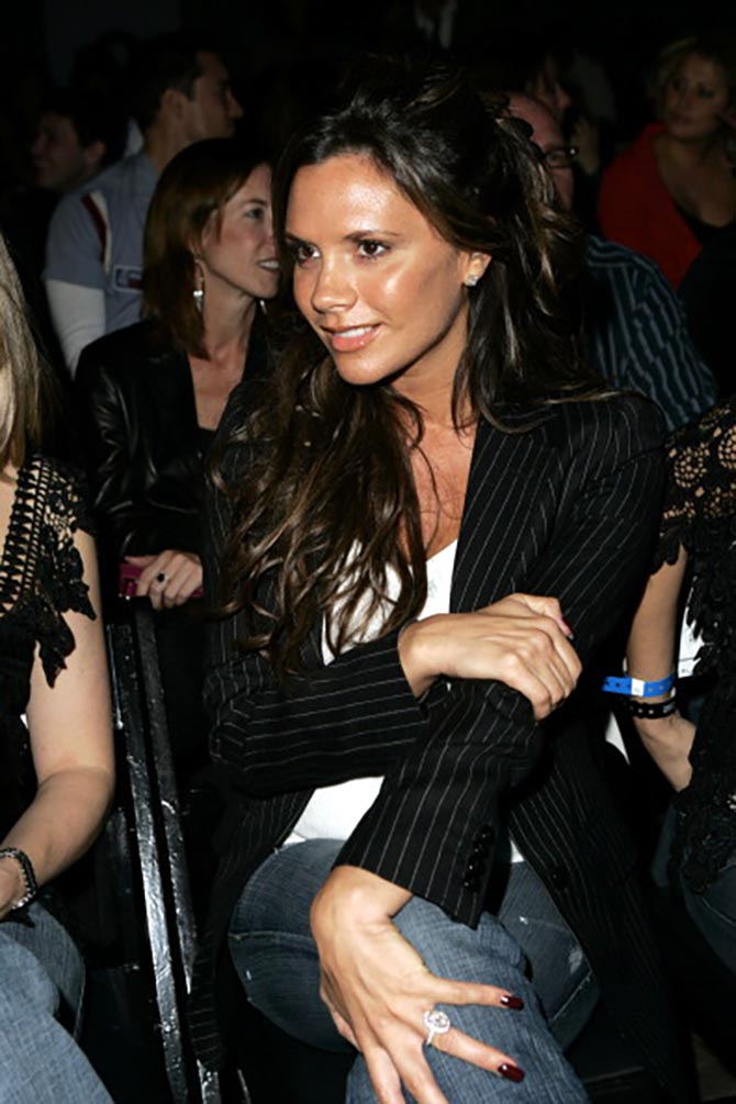 Victoria Beckham wearing her pink diamond engagement ring at a fashion show in 2005. Photo Getty