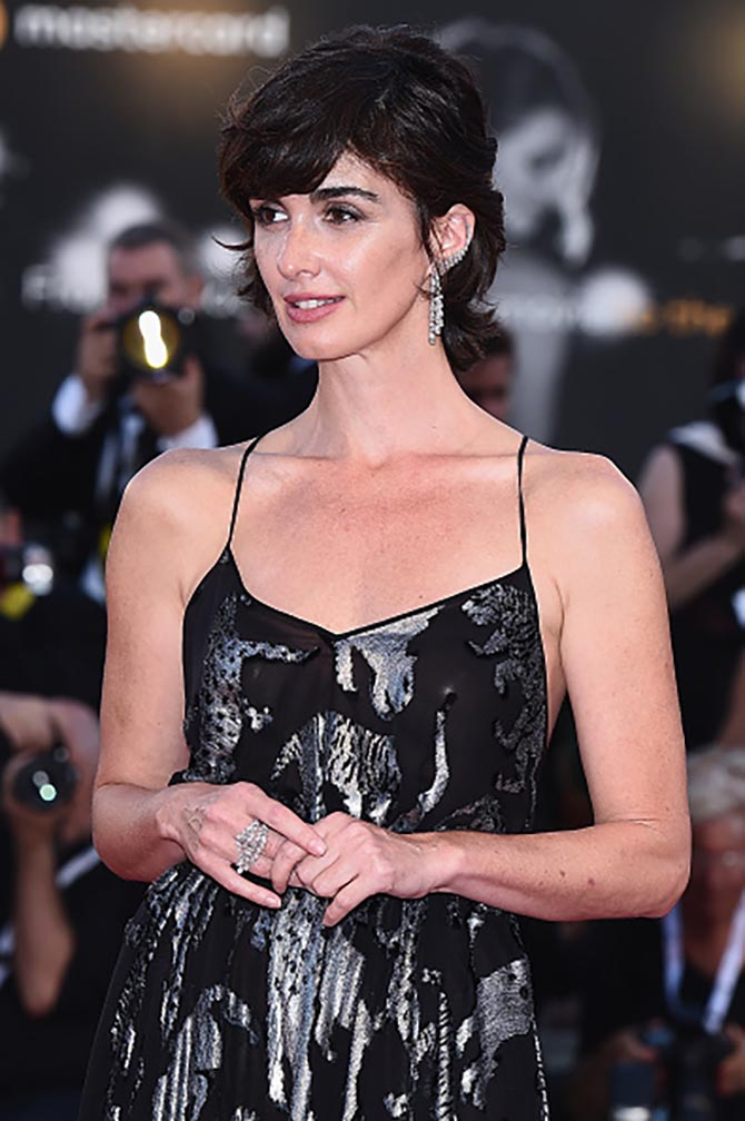 Paz Vega at the 'Roma' screening wearing a Carolina Herrera dress and Messika diamond ear climber and statement ring. Photo Getty