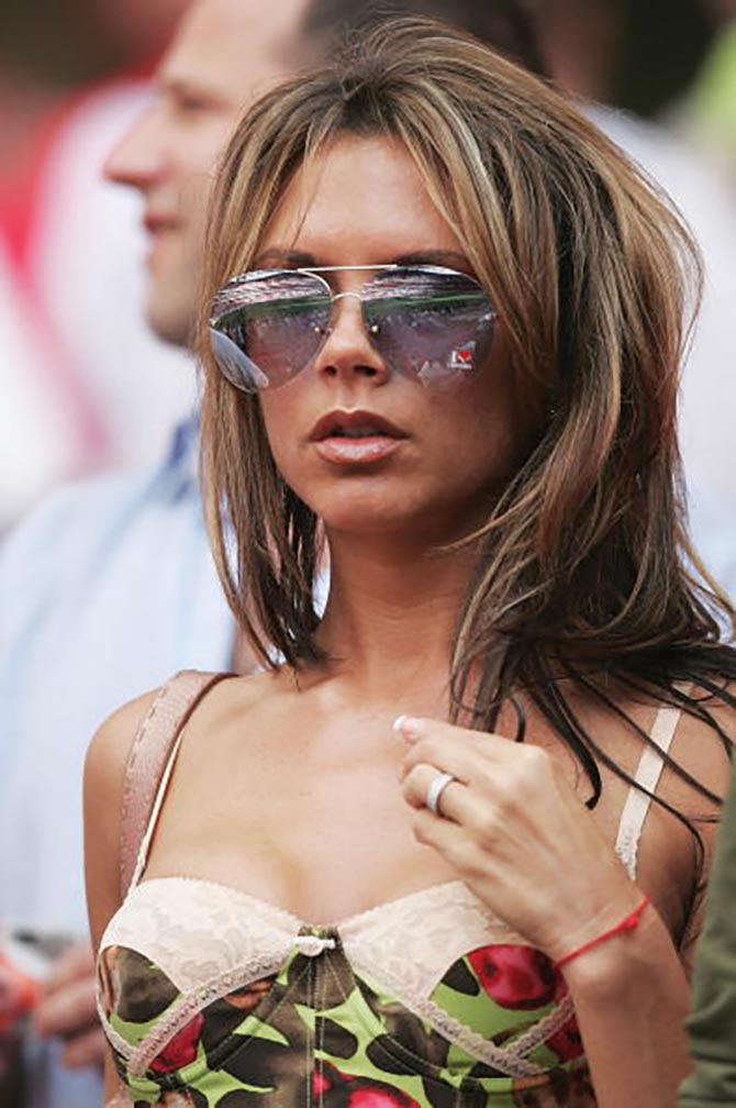 Victoria Beckham wearing her diamond and platinum band at one of David's soccer matches in 2004.