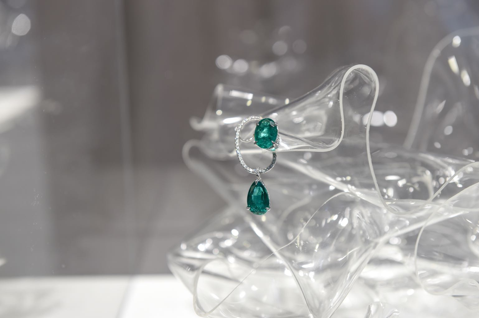 Diamond and emerald Katherine Ear Piece - one of a pair - on display at Jewels Now : Ana Khouri at Phillips New York Photo BFA