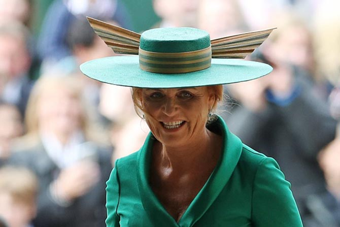 Sarah, Duchess of York wore a dramatic green ensemble with emerald and diamond pendant earrings. The look echoed the emeralds in the bride's tiara.