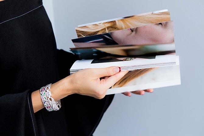 Liza Urla holding her book Gemologue: Street Jewellery Styles & Styling Tips. Photo Julia Flit GEM Kreatives