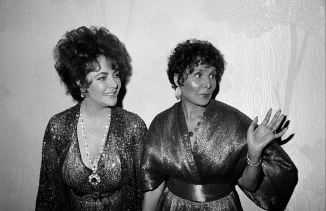 Elizabeth Taylor with Lena Horne who is wearing her diamond bracelets among other jewels. Photo Getty