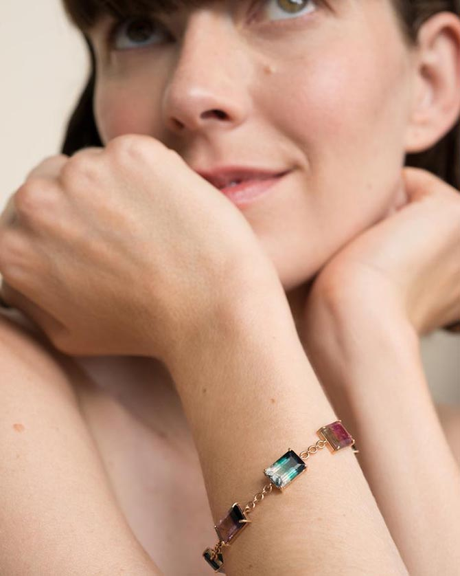 Corey from Irene Neuwirth wearing a one-of-a-kind bicolor tourmaline 18K rose gold link bracelet. Photo courtesy