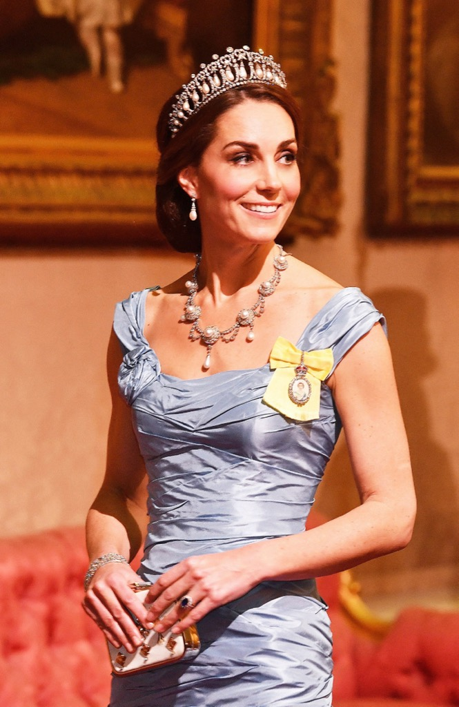 Catherine, Duchess of Cambridge wearing the Cambridge Lover's Knot tiara among other jewels with an Alexander McQueen gown