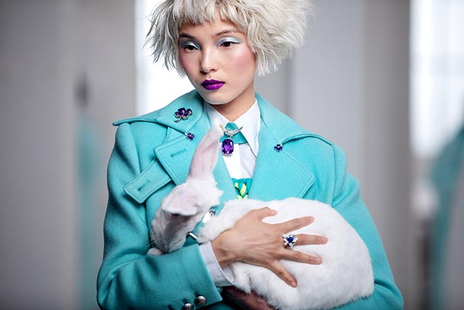 Xiao Wen Ju wearing Tiffany jewels and holding a white rabbit in the holiday video. Photo courtesy