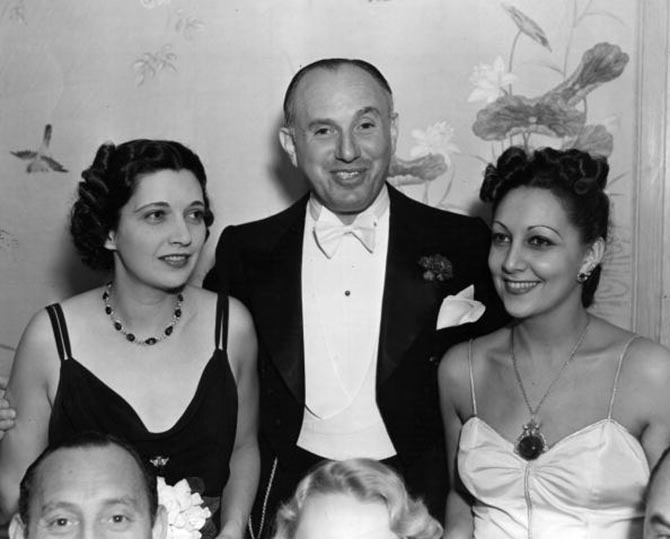 Actress Kay Francis with Warner Brothers studio chief, Jack Warner and his wife Ann who is wearing her emerald and diamond necklace. Photo Getty