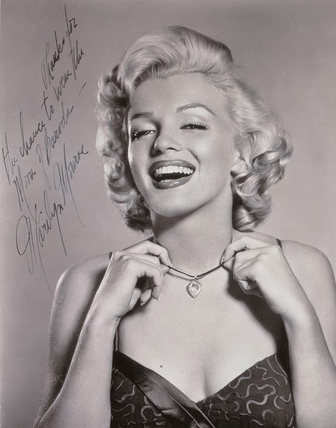 Marilyn Monroe wearing the Moon of Baroda diamond in an autographed and inscribed image being offered at Christie's with the diamond. Photo Christie's