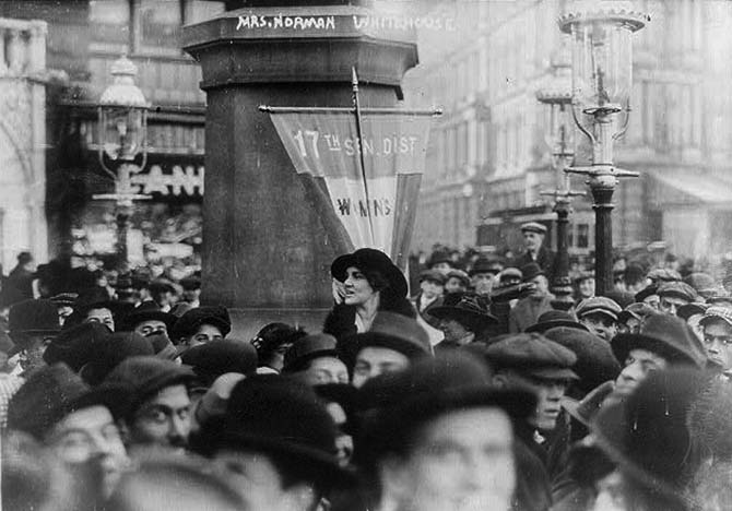 Vira Boarman Whitehouse making a public speech for Women's Suffrage on the streets of New York in December 1913. Photo via Wikipedia Commons