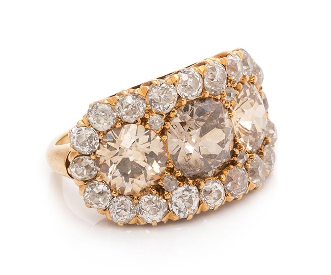 A Victorian rose gold, colored diamond and diamond cluster ring, estimate $4,000-$6,000