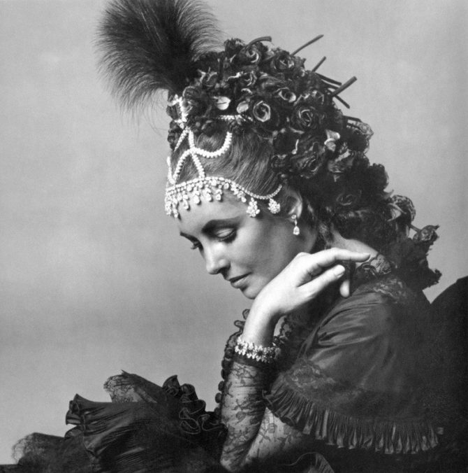 One of a series of photos Cecil Beaton took of Elizabeth Taylor in advance of the 1971 Proust ball. She wore several jewels including a Van Cleef & Arpels necklace worn on her head along with her Bulgari emerald and diamond brooch.